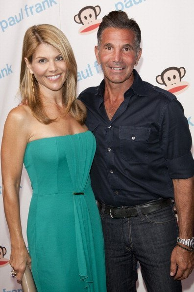 Lori Loughlin and Massimo attend Paul Frank's Fashion's Night Out at ADBD Gallery on September 8, 2011, in Los Angeles, California.| Source: Getty Images