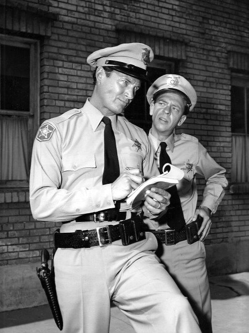 "Don Knotts (Barney Fife) and Mark Miller from the television program ""The Andy Griffith Show."" 