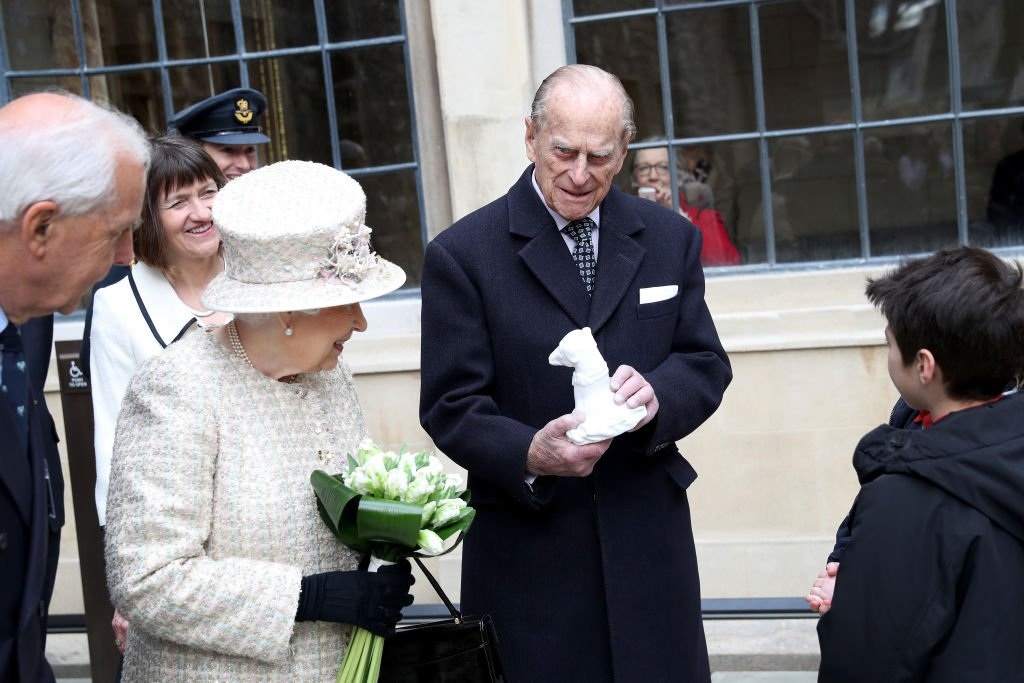 Queen Elizabeth II and Prince Philip, Duke of Edinburgh are greeted by local school children as they open a new development at The Charterhouse at Charterhouse Square on February 28, 2017   Photo: Getty Images