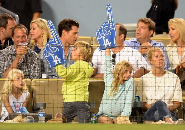 Gwyneth Paltrow (R) and Moses Martin and Apple Martin watch the game between the Arizona Diamondbacks and the Los Angeles Dodgers | Getty Images