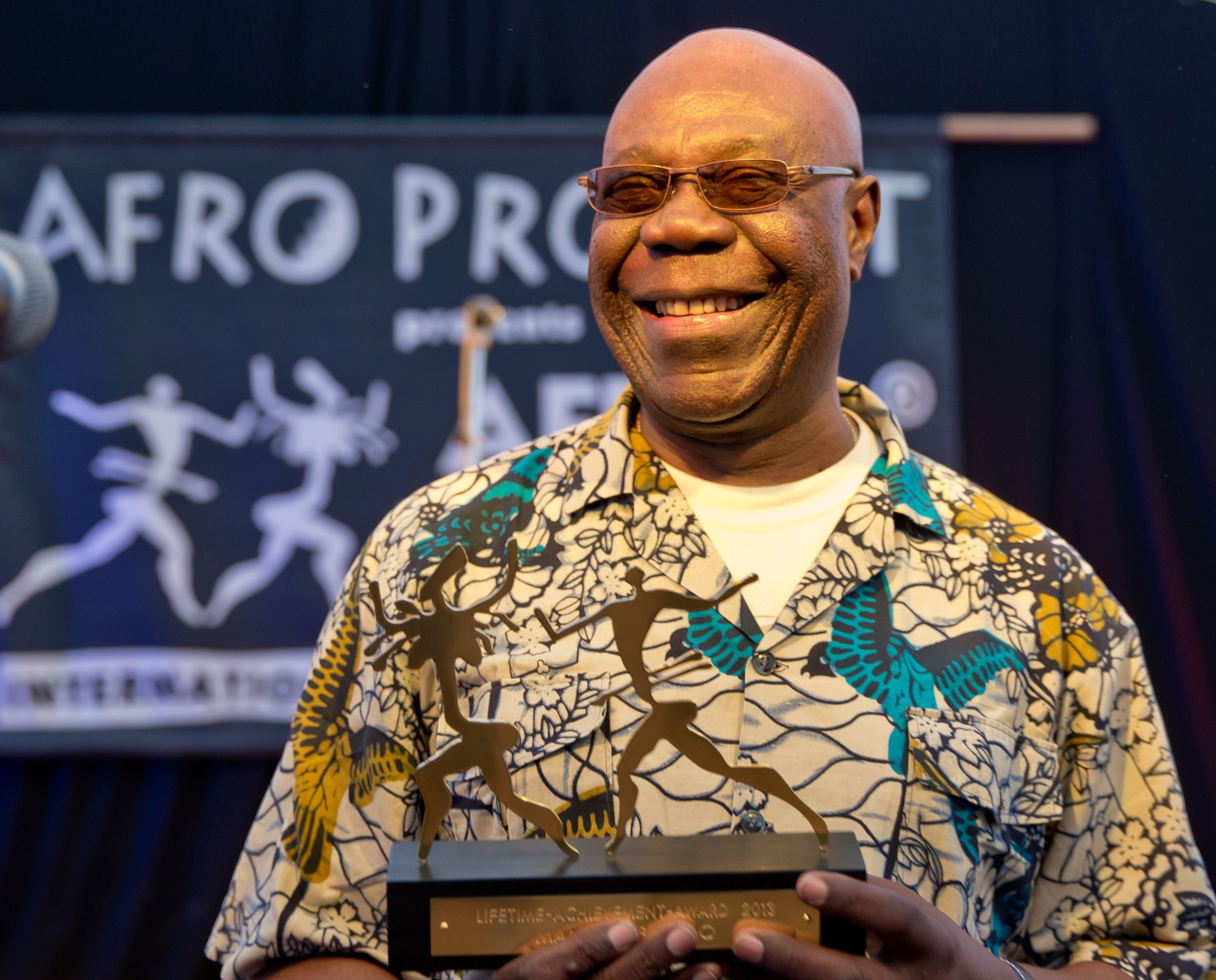 Manu Dibango receiving his Lifetime Achievement Award during the opening of the 25th Africa festival in Germany in June 2013. | Photo: Getty Images