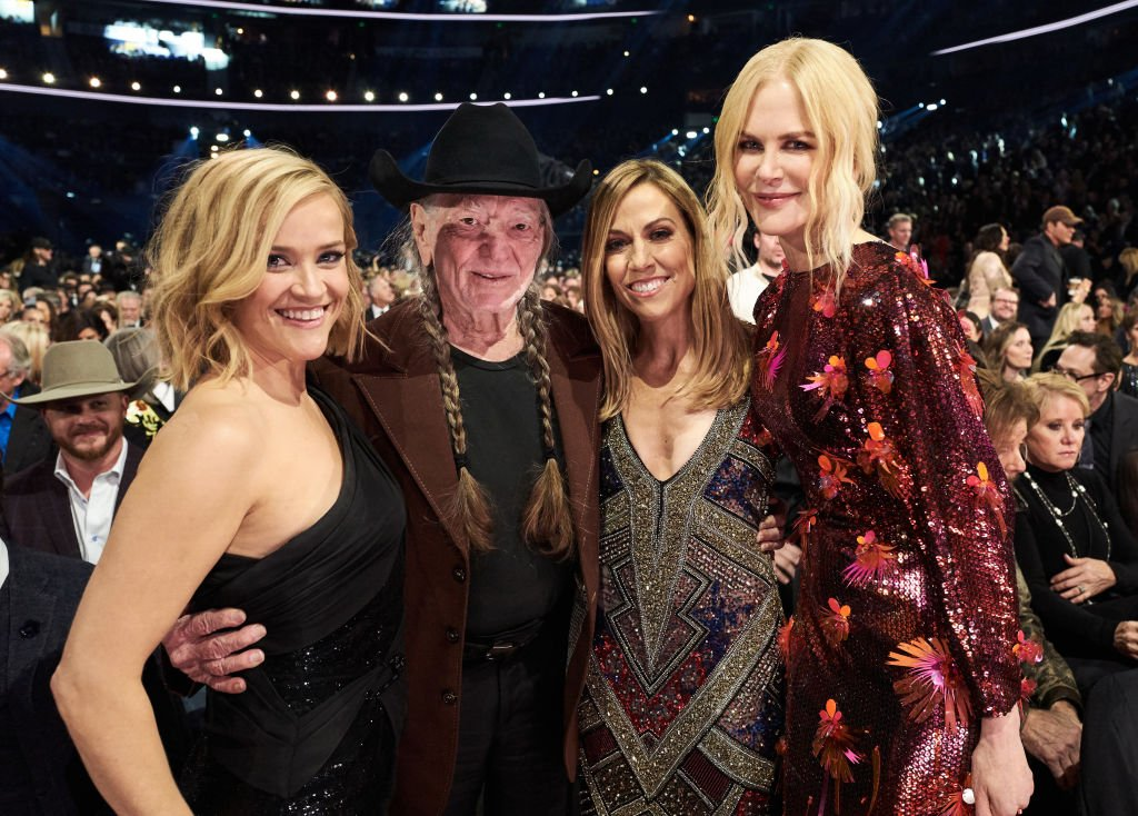 Reese Witherspoon, Willie Nelson, Sheryl Crow and Nicole Kidman attend the 53rd annual CMA Awards at the Bridgestone Arena on November 13, 2019 in Nashville, Tennessee. Image Credit: Getty Images