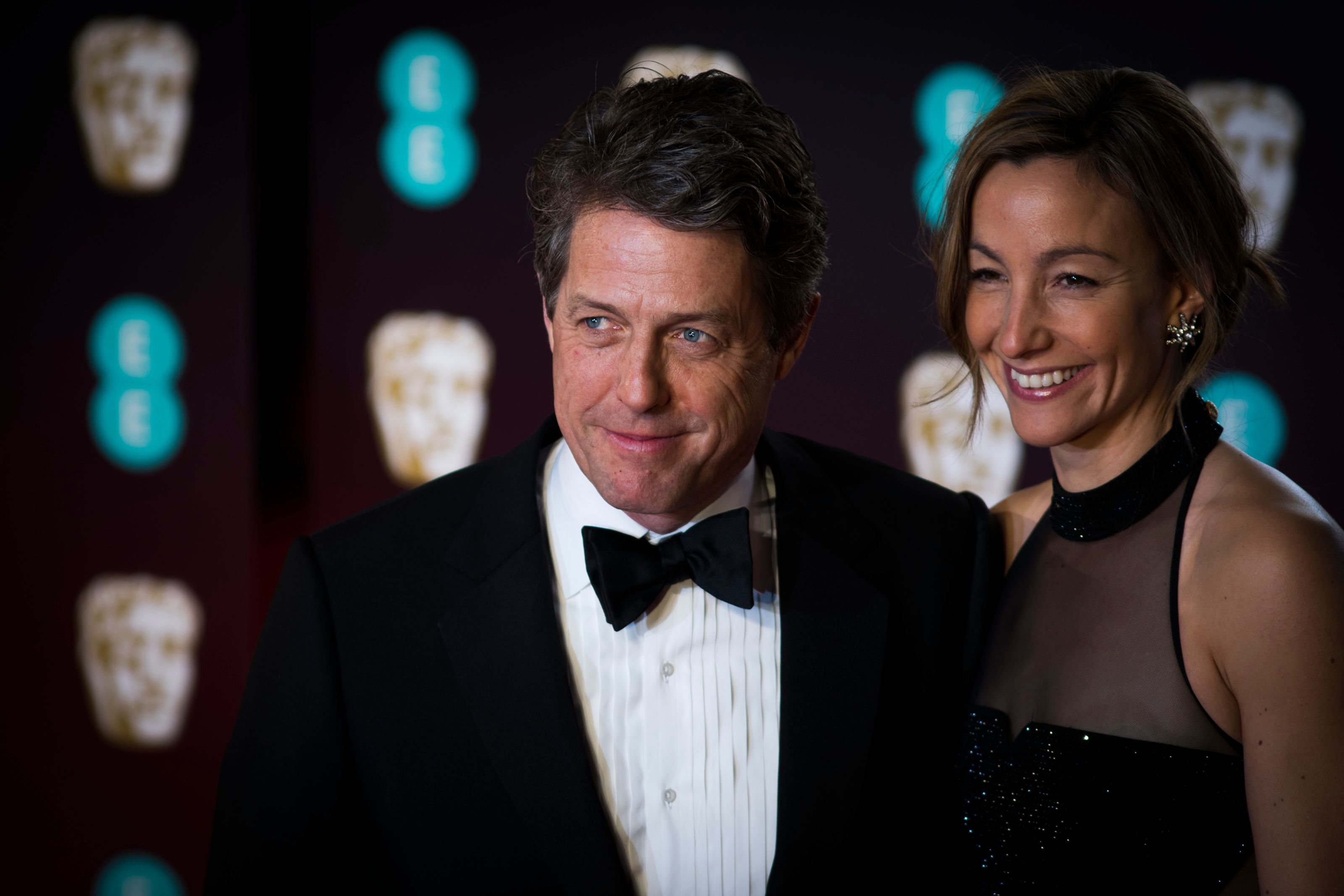 Hugh Grant and Anna Elisabet Eberstein at the 70th EE British Academy Film Awards in 2017 in London, England | Source: Getty Images