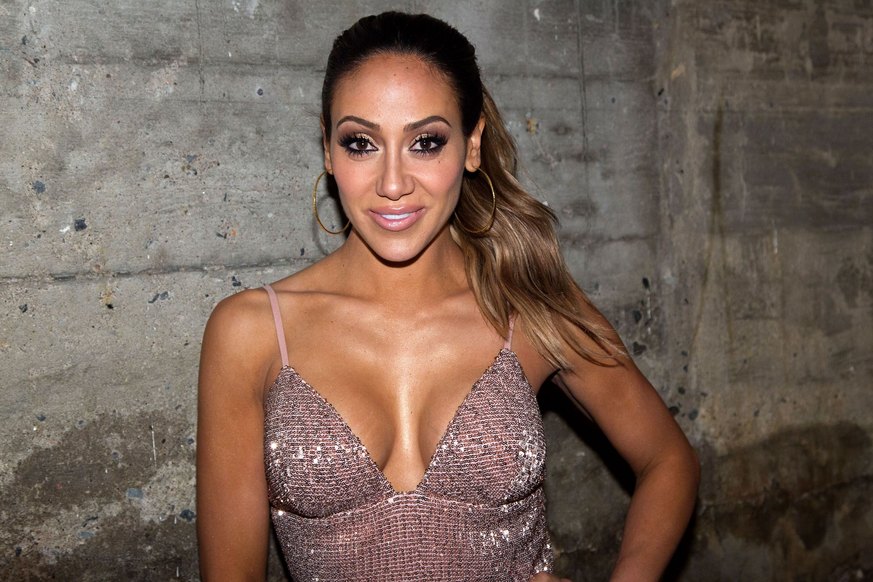 Melissa Gorga flashes a smile during a red carpet event. | Source: Getty Images