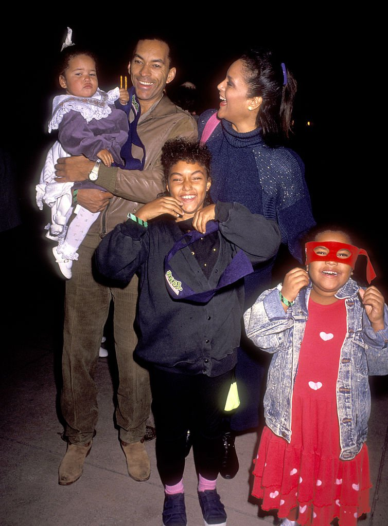 """Jayne Kennedy, her husband Bill Overton, and daughters Savannah and Kopper attend the """"Teenage Mutant Ninja Turtles"""" Universal City premiere in 1990 