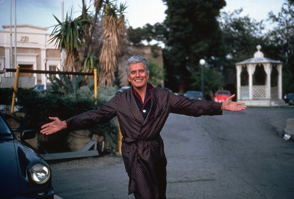 """American actor John Forsythe, on the set of TV series """"Dynasty"""" 
