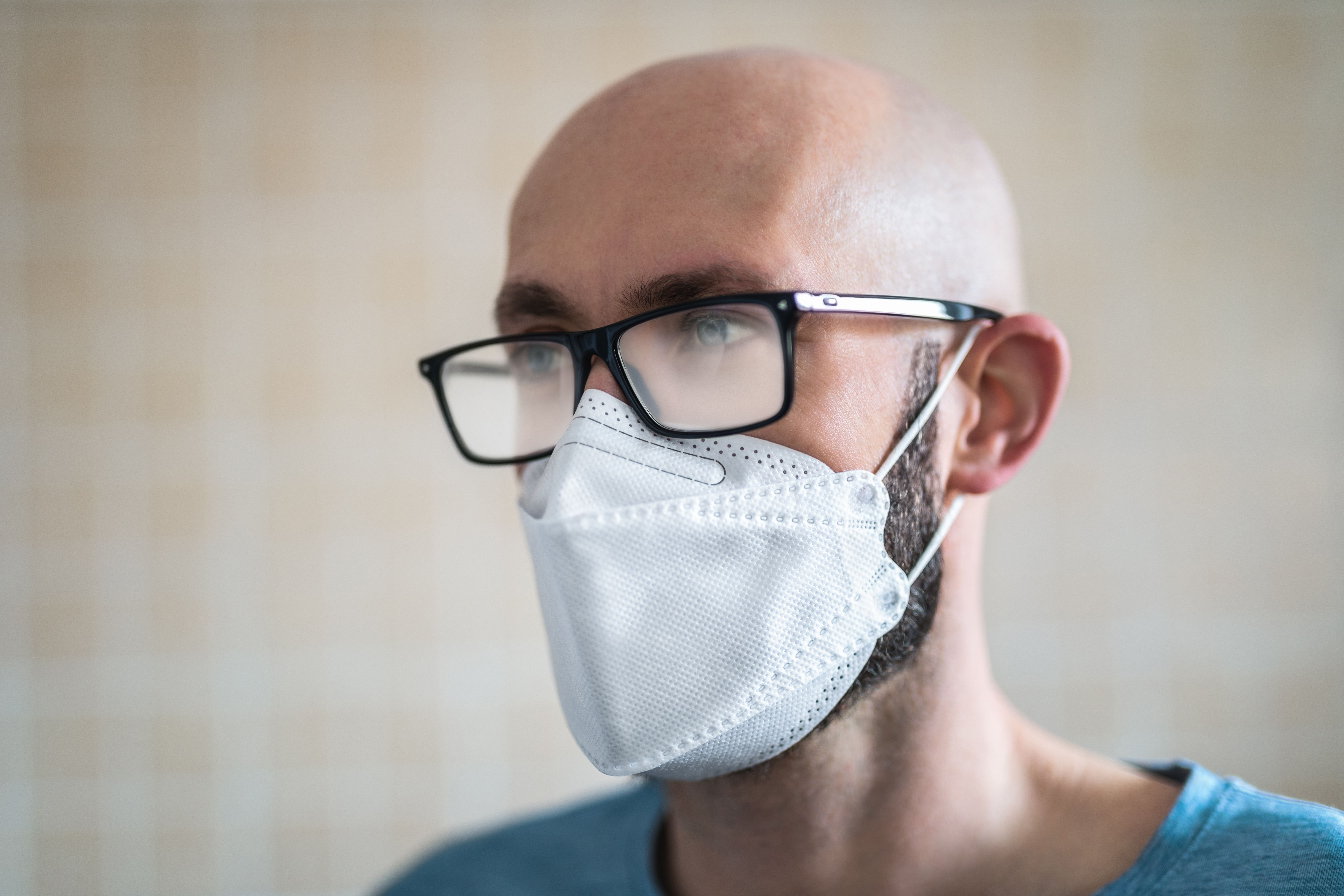 A man wearing glasses and a mask.   Source: Getty Images