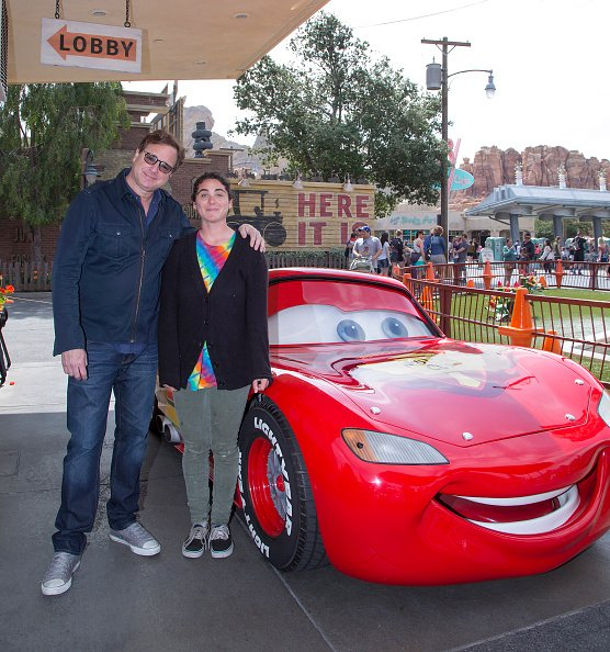 Bob Saget and Jennifer Belle Saget at Disney California Adventure Park in Anaheim, California on March 19, 2016. | Photo: Getty Images