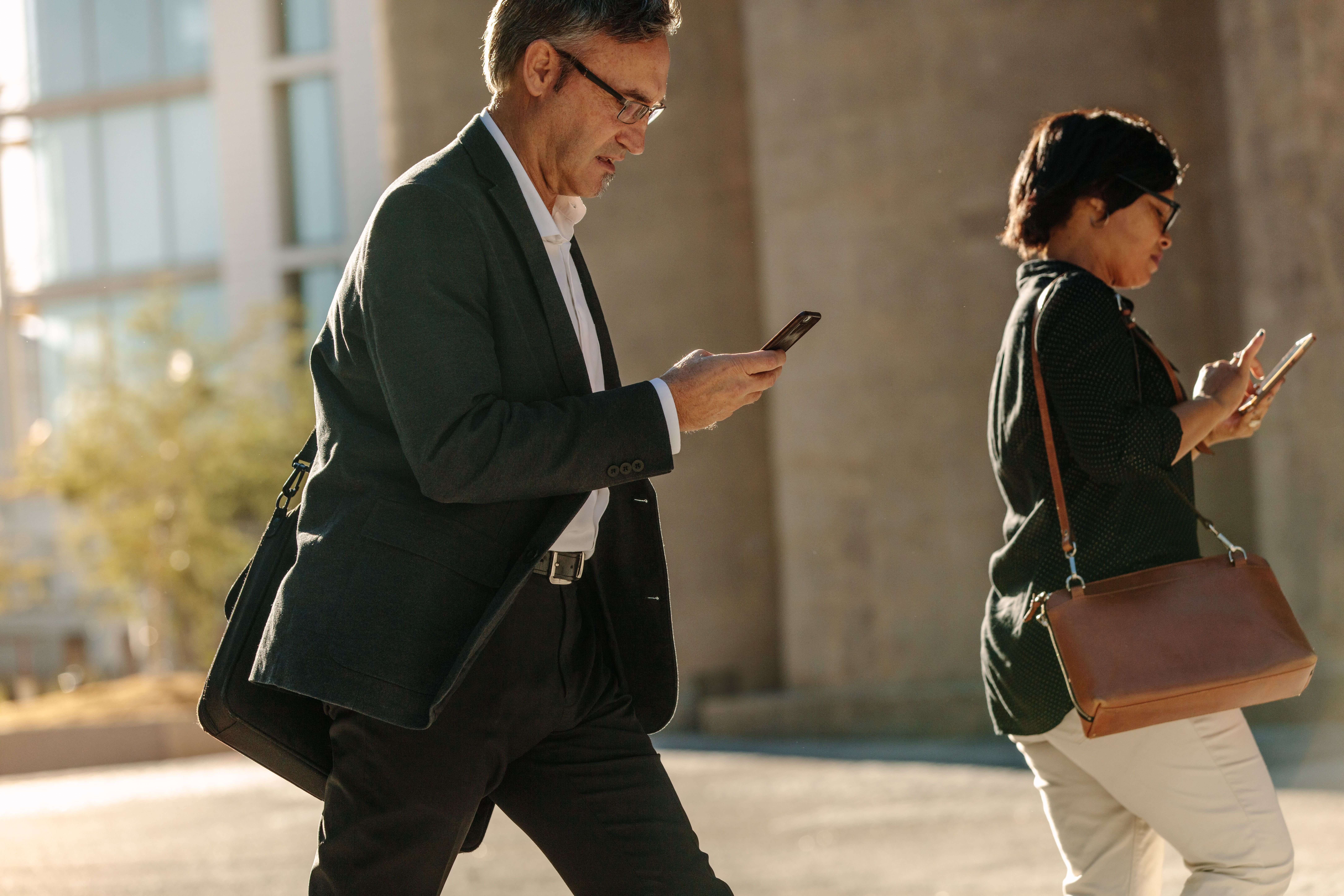 People walking while texting.   Source: Shutterstock