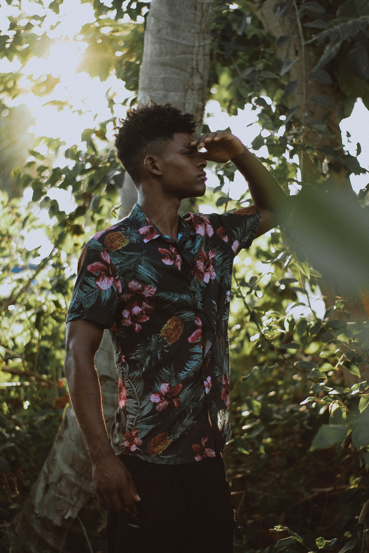 Photo of a man wearing a floral shirt in the woods   Photo: Pexels