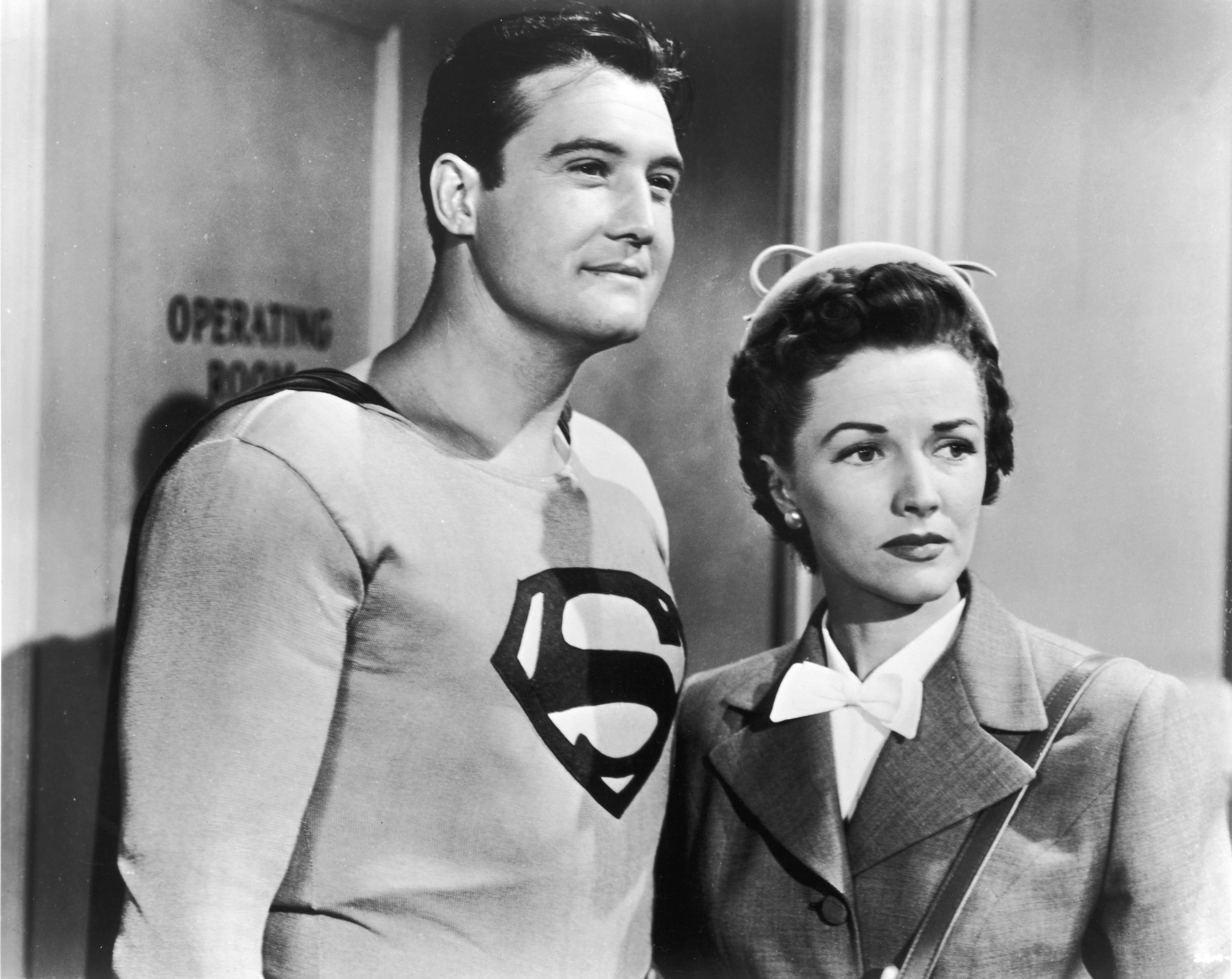 """George Reeves, as Superman, with Phyllis Coates, as Lois Lane, in a still from """"Adventures of Superman,"""" circa 1952 