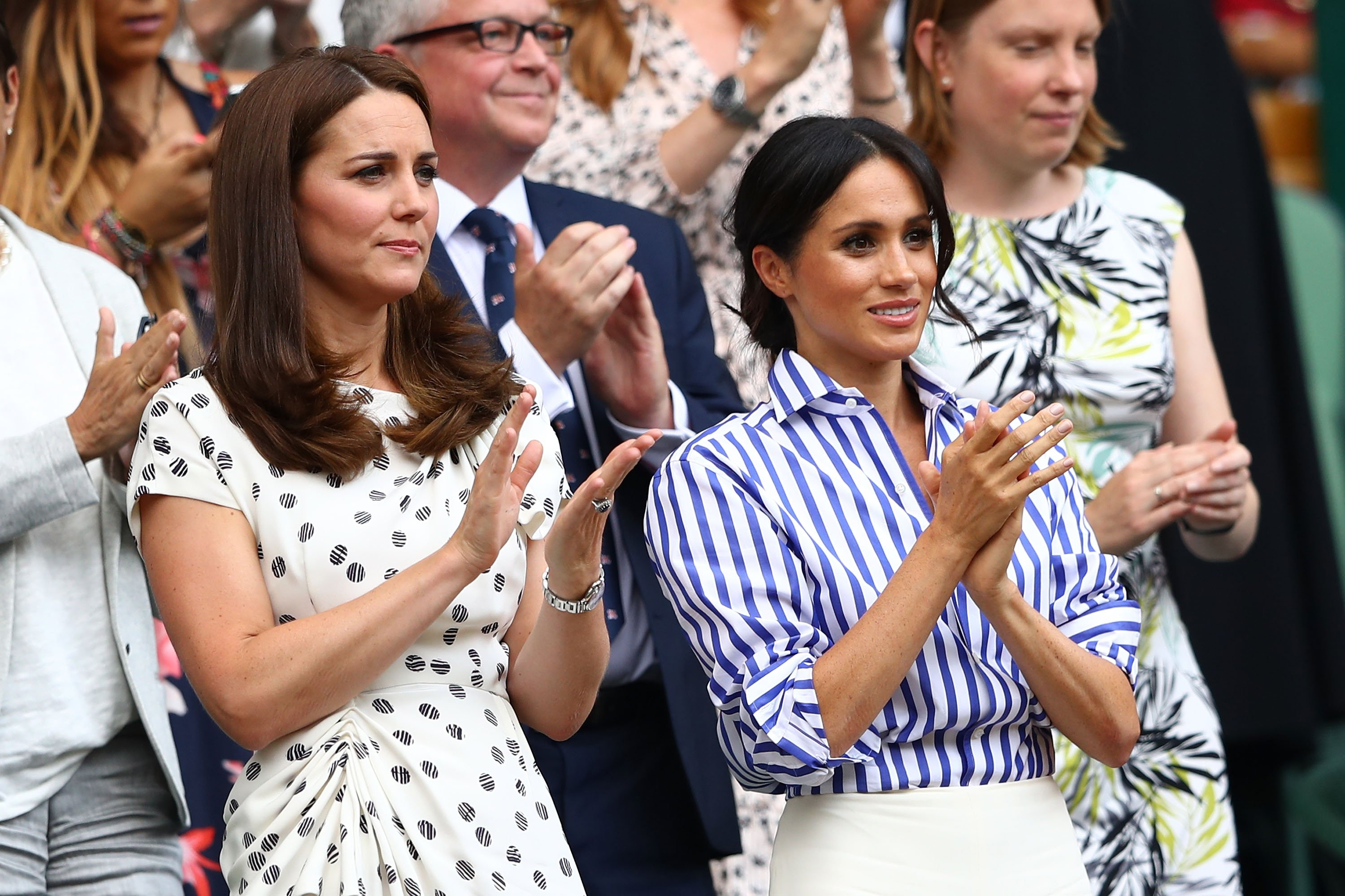Kate Middleton and Meghan Markle applaud ahead of the Ladies' Singles final match on day twelve of the Wimbledon Lawn Tennis Championships at All England Lawn Tennis and Croquet Club on July 14, 2018   Photo: Getty Images