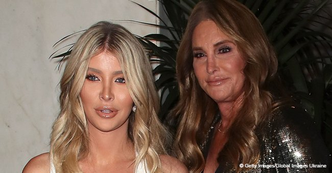 Caitlyn Jenner flashes lace bra under plunging blazer while hugging her 47 years younger partner