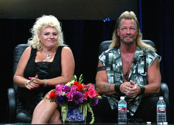 "Bounty Hunter Dog Chapman (R) and his wife Beth Chapman of ""Dog The Bounty Hunter"" speaks with the press at the TCA Press Tour Cable at the Century Plaza Hotel on July 21, 2004, in Los Angeles, California. 