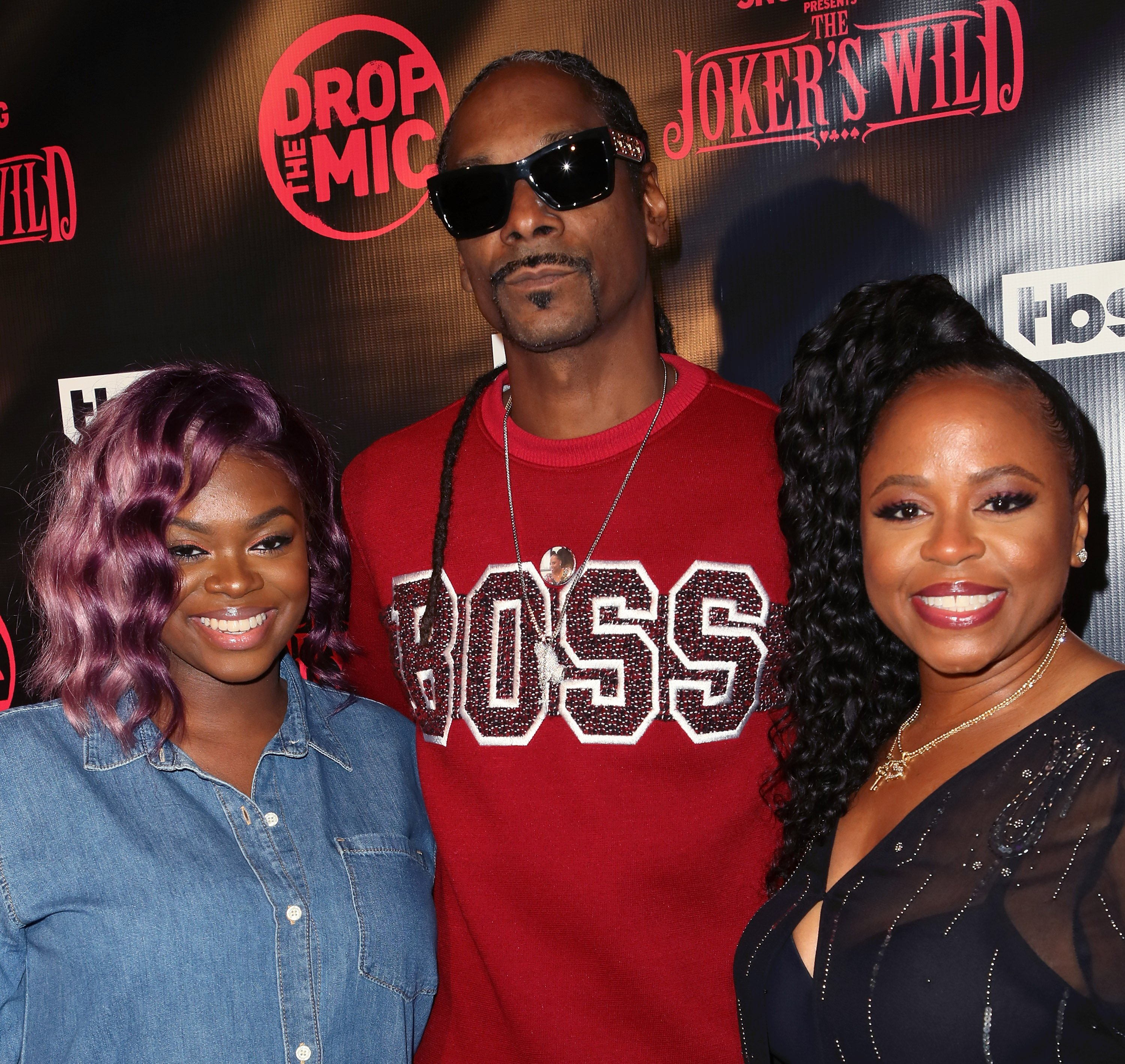"""Cori Broadus, Snoop Dogg, and Shante Broadus at the premiere for TBS's """"Drop The Mic"""" and """"The Joker's Wild"""" at The Highlight Room in Los Angeles, California 