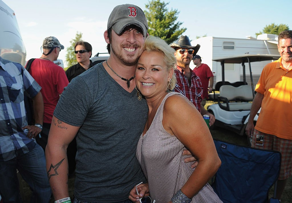 Lorrie Morgan and son Jesse Keith Whitley backstage at the Country Thunder Music Festival, July 2011 | Source: Getty Images