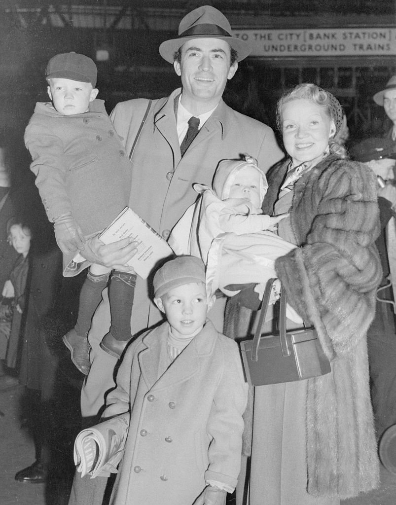Gregory Peck and wife Greta pose with their three sons. Gregory holds Stephen, Greta holds Carey, and Jonathan is at bottom   Photo: Getty Images