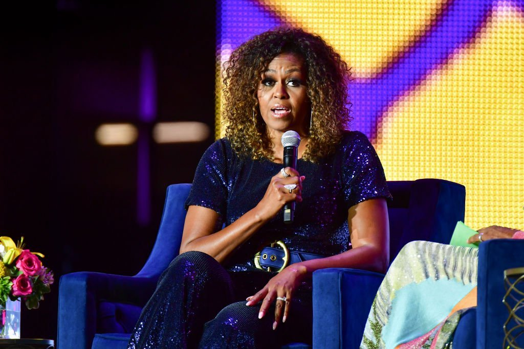 A conversation with Michelle Obama takes place during the 2019 ESSENCE Festival at the Mercedes-Benz Superdome | Photo: Getty Images
