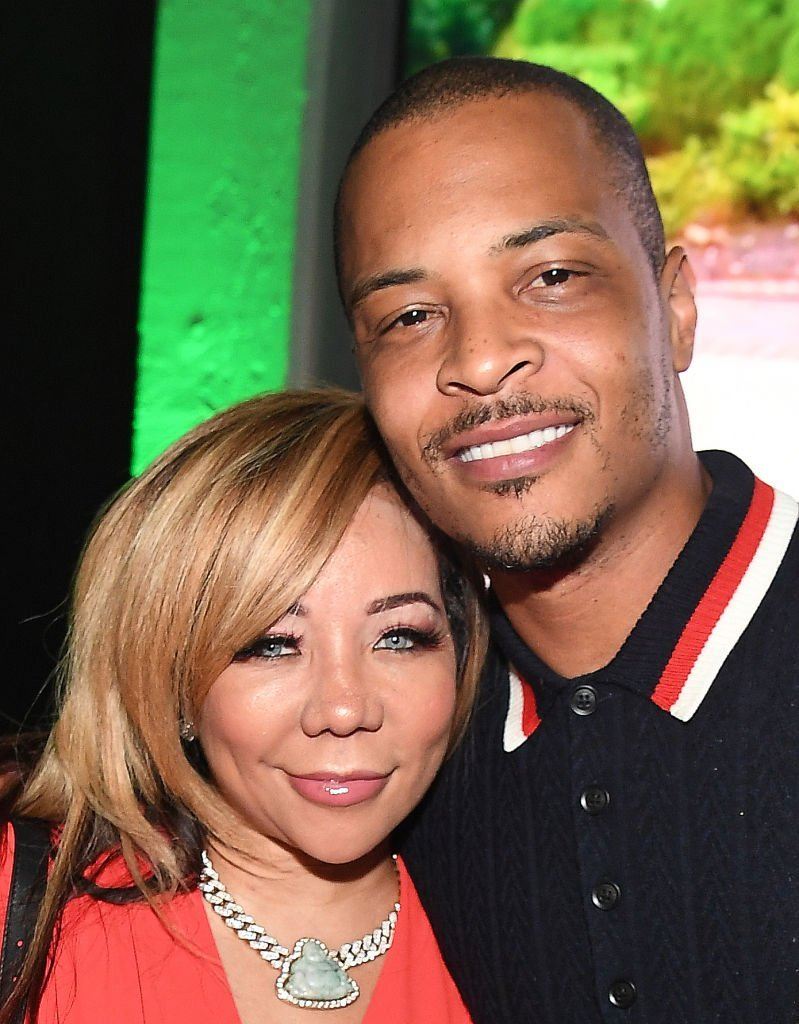 "Tip ""T.I"" Harris and Tameka ""Tiny"" Harris attend ""The Grand Hustle"" Exclusive Viewing Party at The Gathering Spot 