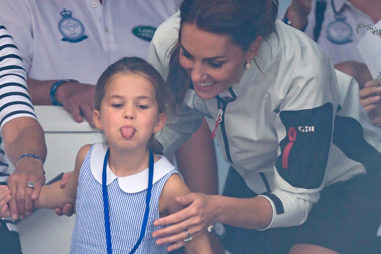 Princess Charlotte sticks her tongue out to the crowd during the King's Cup charity race. | Source: Getty Images