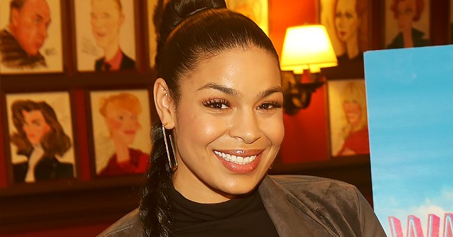 'American Idol' Winner Jordin Sparks Is Content Lying in Bed Holding Flowers from Her Husband