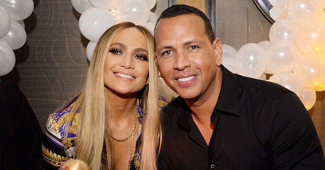 Check Out Jennifer Lopez & Alex Rodriguez's Matching Gold Robes Which They Wore during Their New Year's Celebration