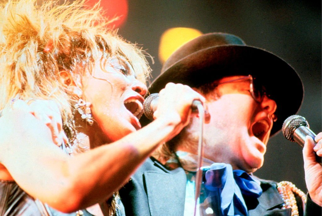 Tina Turner is joined onstage by Elton John, on one of four nights at Wembley Arena, London, during her Private Dancer Tour | Getty Images