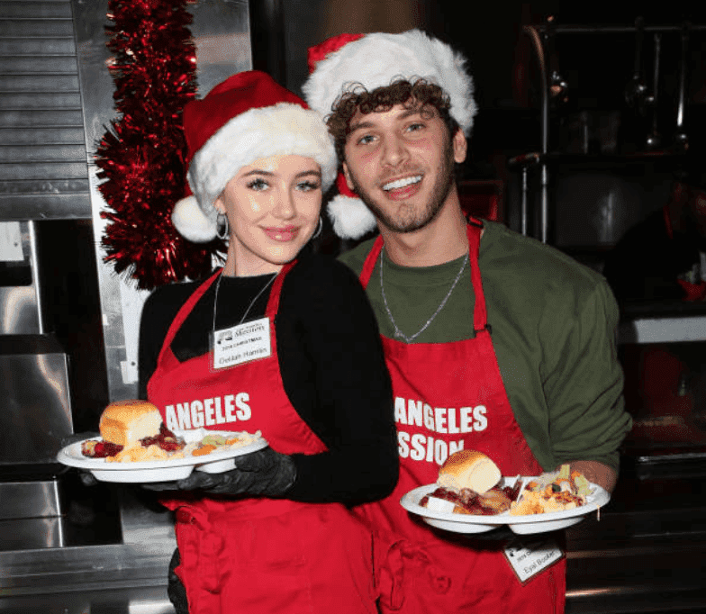 "Delilah Belle Hamlin and her boyfriend Eyal Booker make meals for the homeless for the ""Christmas Celebration On Skid Row"" at the Los Angeles Mission, on December 23, 2019, in Los Angeles, California