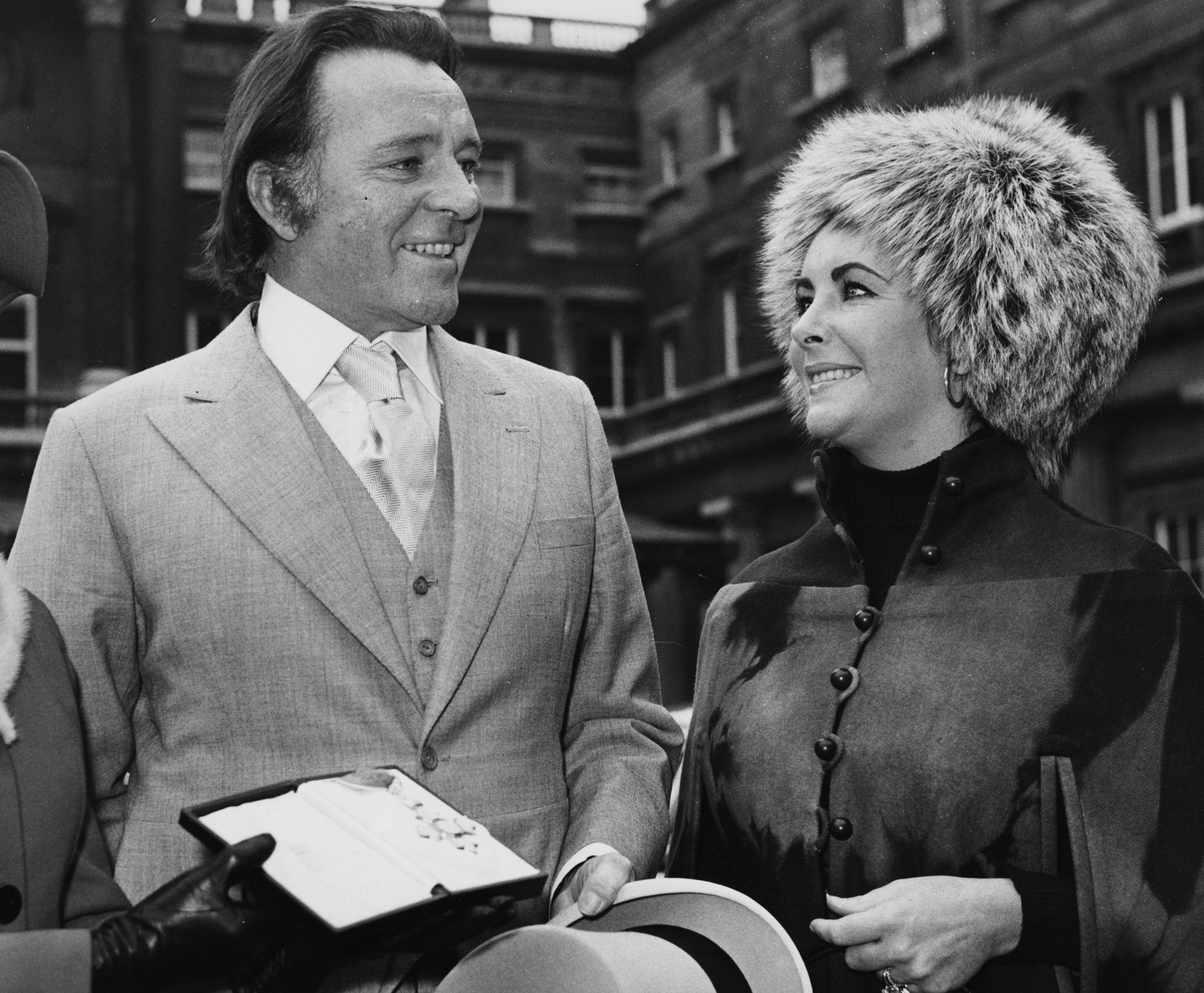 Richard Burton and Elizabeth Taylor after he received his investiture from Buckingham Palace. November 10th 1970.   Photo: GettyImages