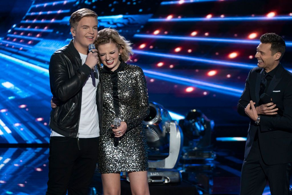 """Caleb Lee Hutchinson, Maddie Poppe and Ryan Seacrest in the """"American Idol"""" finale in 2018 