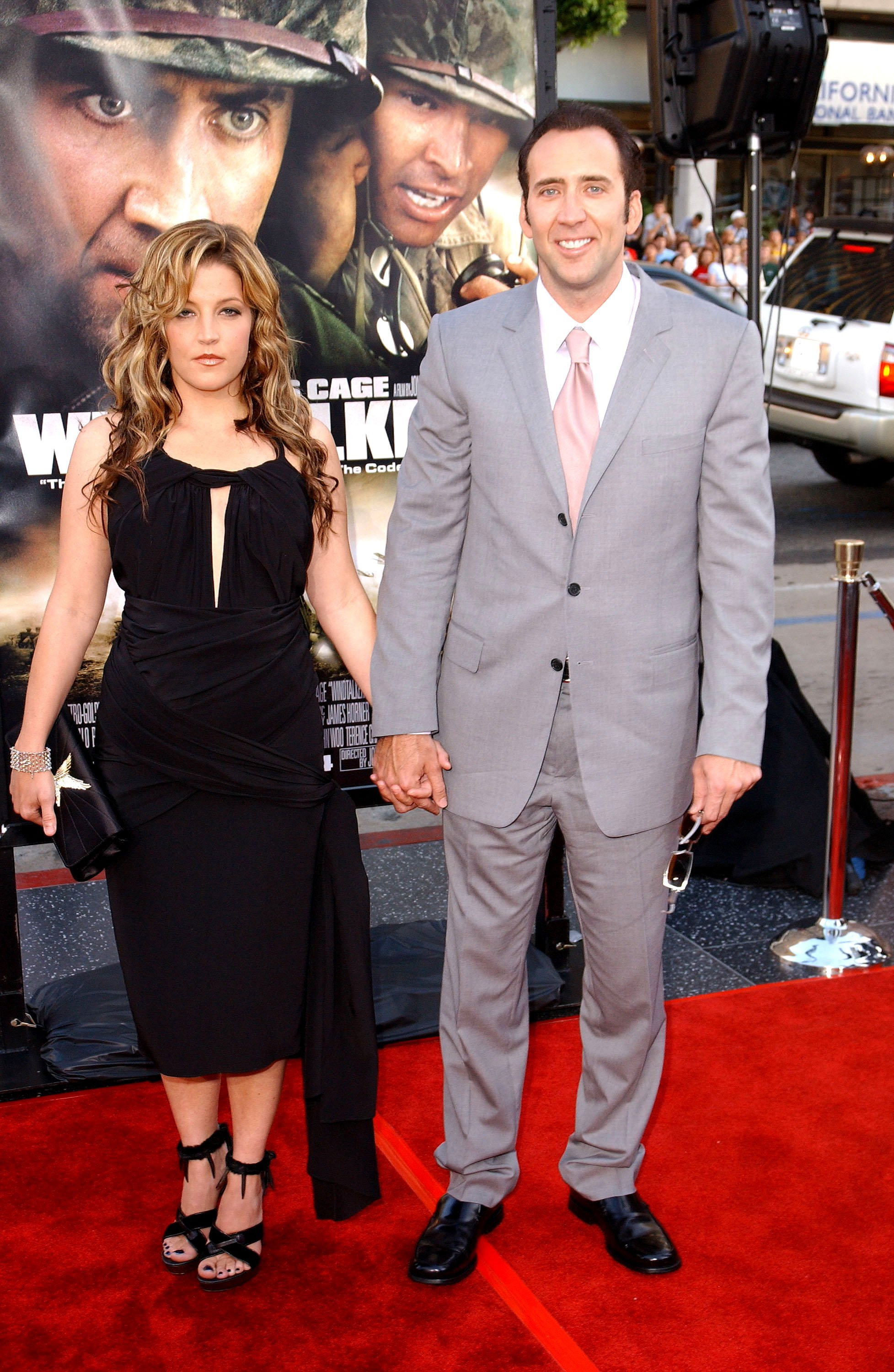"Lisa Marie Presley and actor Nicolas Cage attend the Los Angeles Premiere of MGM's ""Windtalkers"" at Grauman's Chinese Theatre on June 11, 2002, in Hollywood, California. 