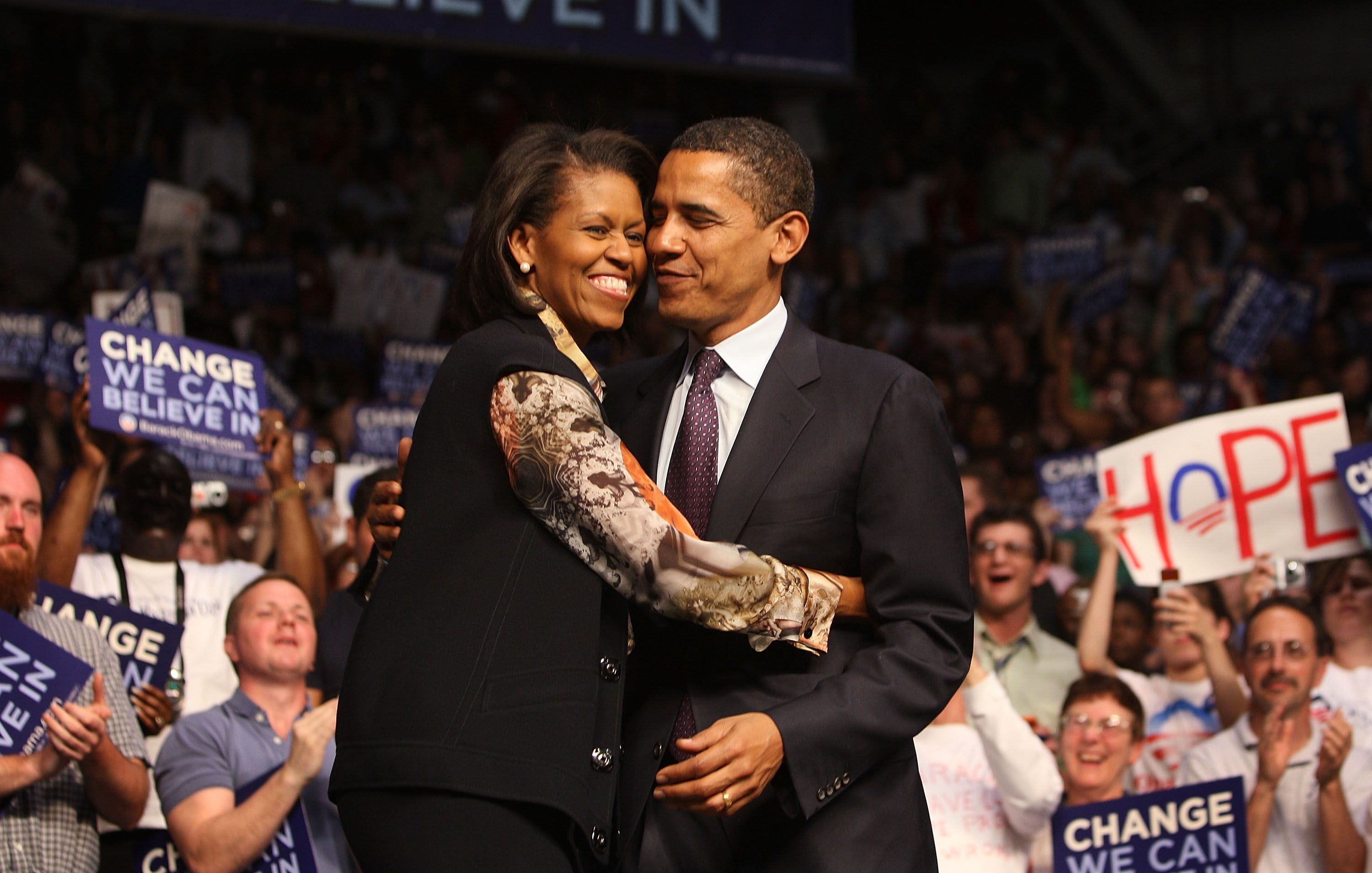 Barack Obama and Michelle Obama embrace each other at a rally April 22, 2008 in Evansville, Indiana. | Source: Getty Images