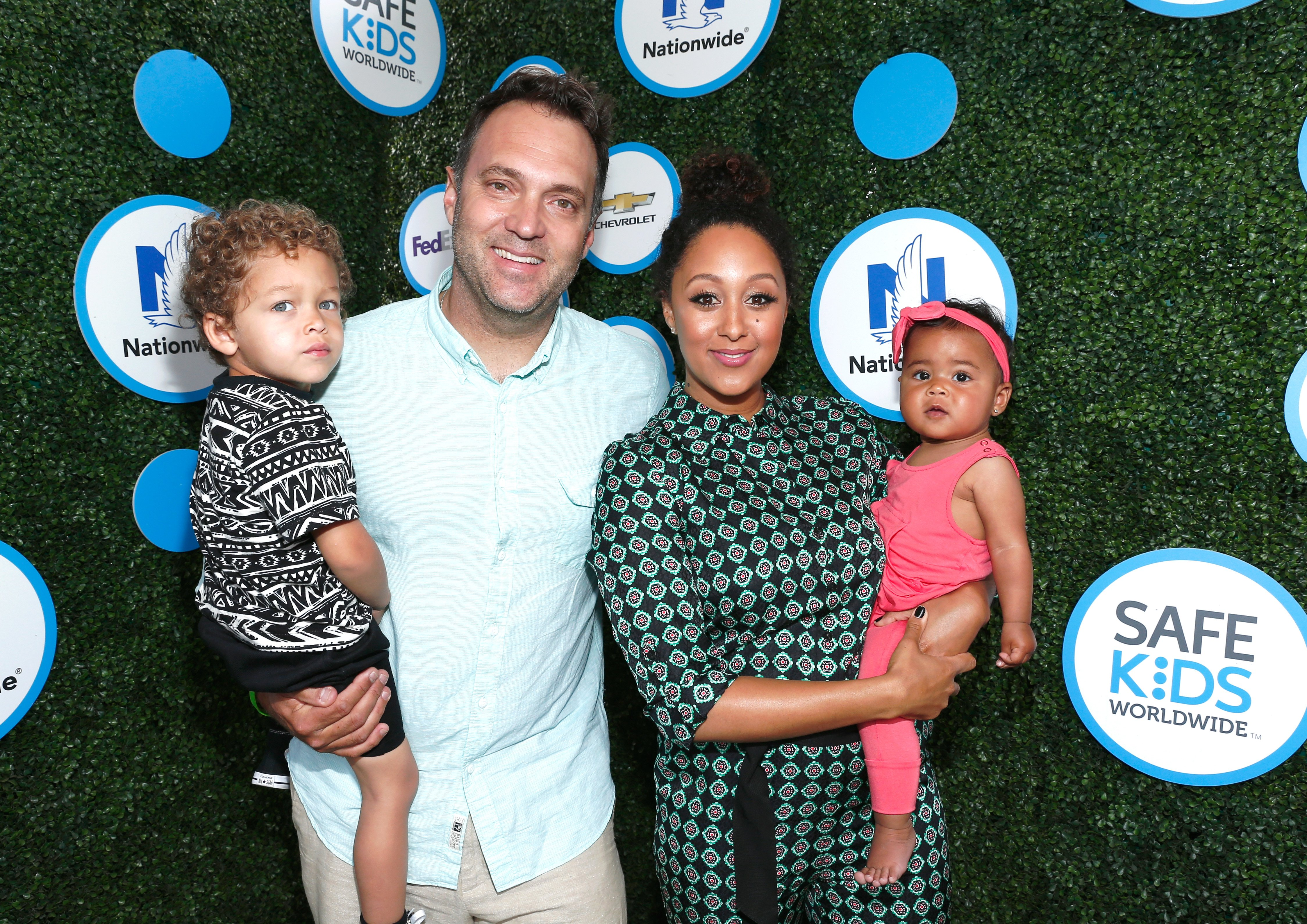 Adam Housley and Tamera Mowry with their two children at the Safe Kids Day at Smashbox Studios on April 24, 2016 in Culver City, California.| Source: Getty Images