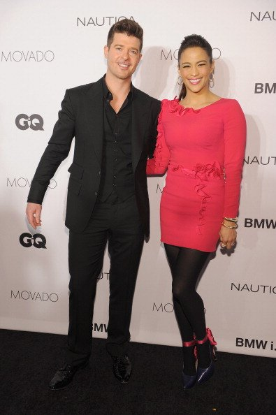 Robin Thicke and actress Paula Patton walk the red carpet at the 2013 GQ Gentlemen's Ball presented by BMW i, Movado, and Nautica at IAC Building on October 23, 2013, in New York City. | Source: Getty Images.