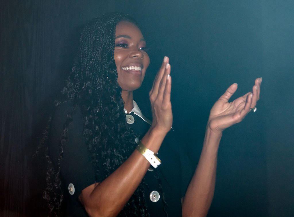 Gabrielle Union claps her hands during  Dwyane Wade's jersey retirement celebration hosted by LYFE Brand at HYDE American Airlines Arena on February 22, 2020, in Miami, Florida | Source: Getty Images