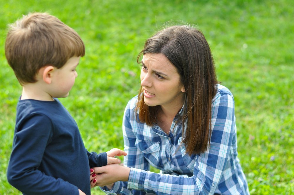 Mother Talking to her son in the park. | Photo: Shutterstock
