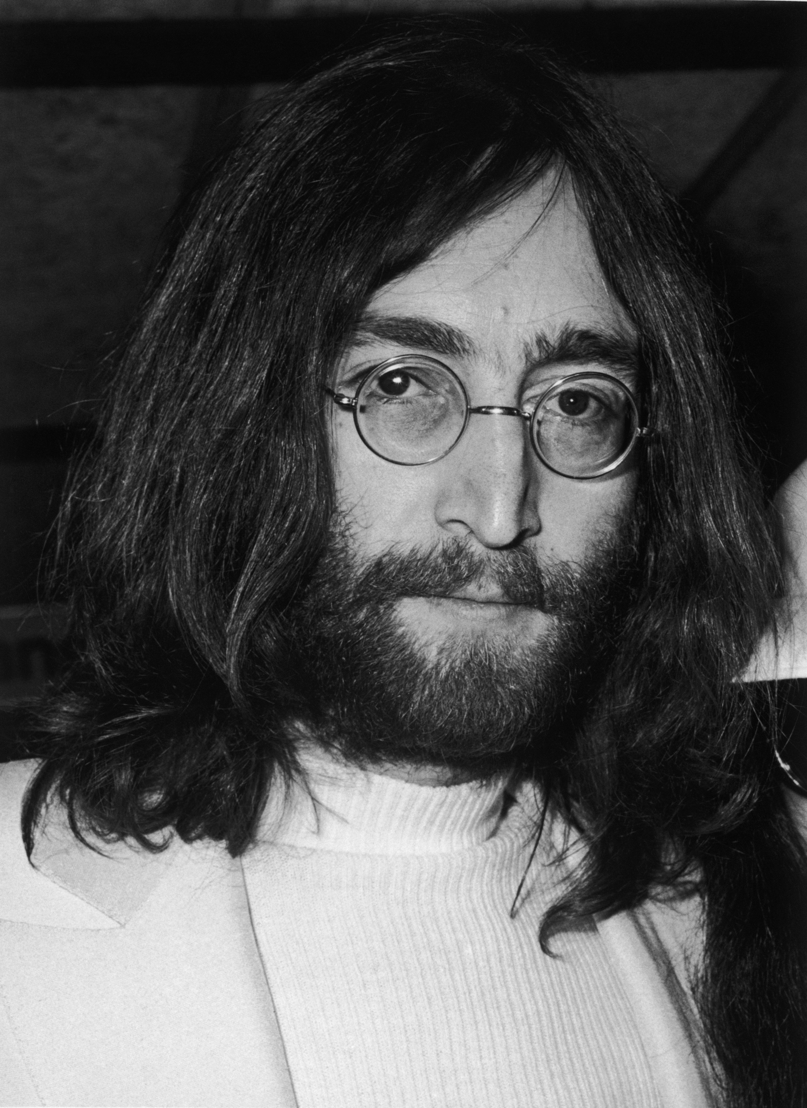 "John Lennon of ""The Beatles"" at a press conference at Heathrow airport. 