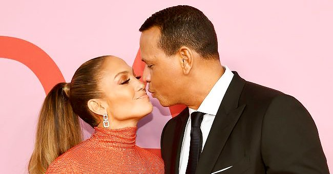 J Lo Is Glowing In a Chic White Blouse & Cut-Out Pants Following Her Split with Alex Rodriguez