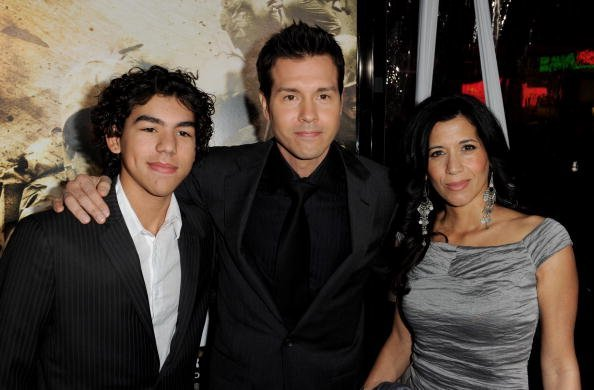 """Jon Seda (C), his son Jon Seda Jr. (L) and his wife Lisa arrive at the premiere of HBO's """"The Pacific"""" at the Chinese Theater on February 24, 2010, in Los Angeles, California. 
