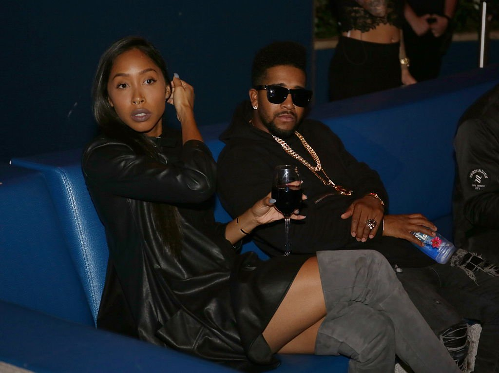 Apryl Jones sips on a glass of wine while sitting next to her boyfriend Omarion at The Pool After Dark at Harrah's Resort on October 23, 2015, in Atlantic City, New Jersey.