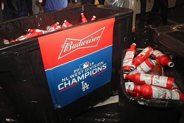 Budweiser beer is seen as the Los Angeles Dodgers celebrate in the clubhouse after defeating the Baltimore Orioles and clinching the National League West Division Title at Oriole Park at Camden Yards on September 10, 2019 in Baltimore, Maryland | Photo: Getty Images
