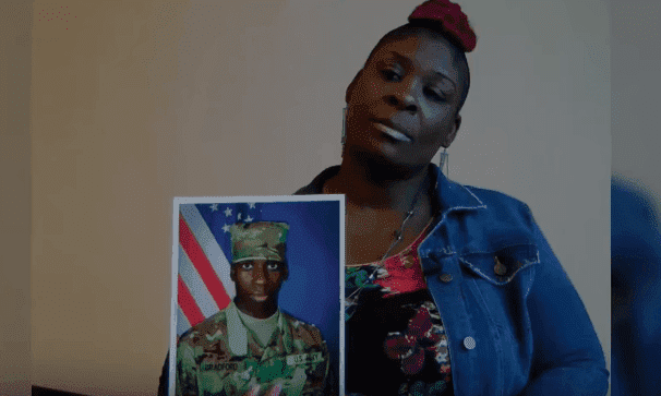 April Pipkins, EJ's mother, holds a photo of her late son as she demands justice. | Photo: YouTube/NBC News