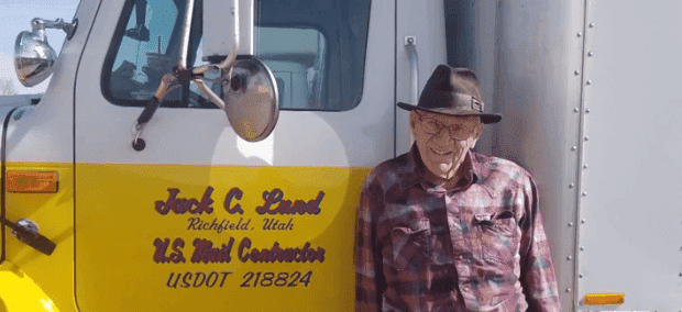 Jack Lund posing next to his mail truck | Photo: KSL-TV