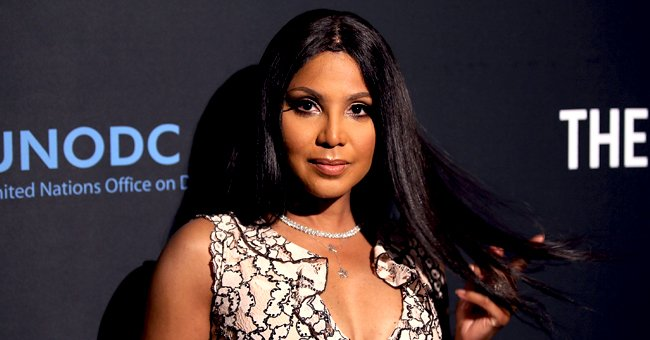Toni Braxton's Son Diezel Shows His Growing Mustache in Pics Posing outside in a White Sweater