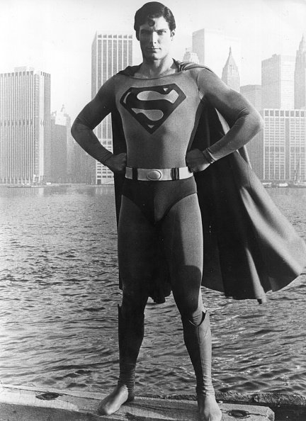 "Christopher Reeve stands before the Manhattan skyline dressed as the comic-book hero of the film ""Superman."" 