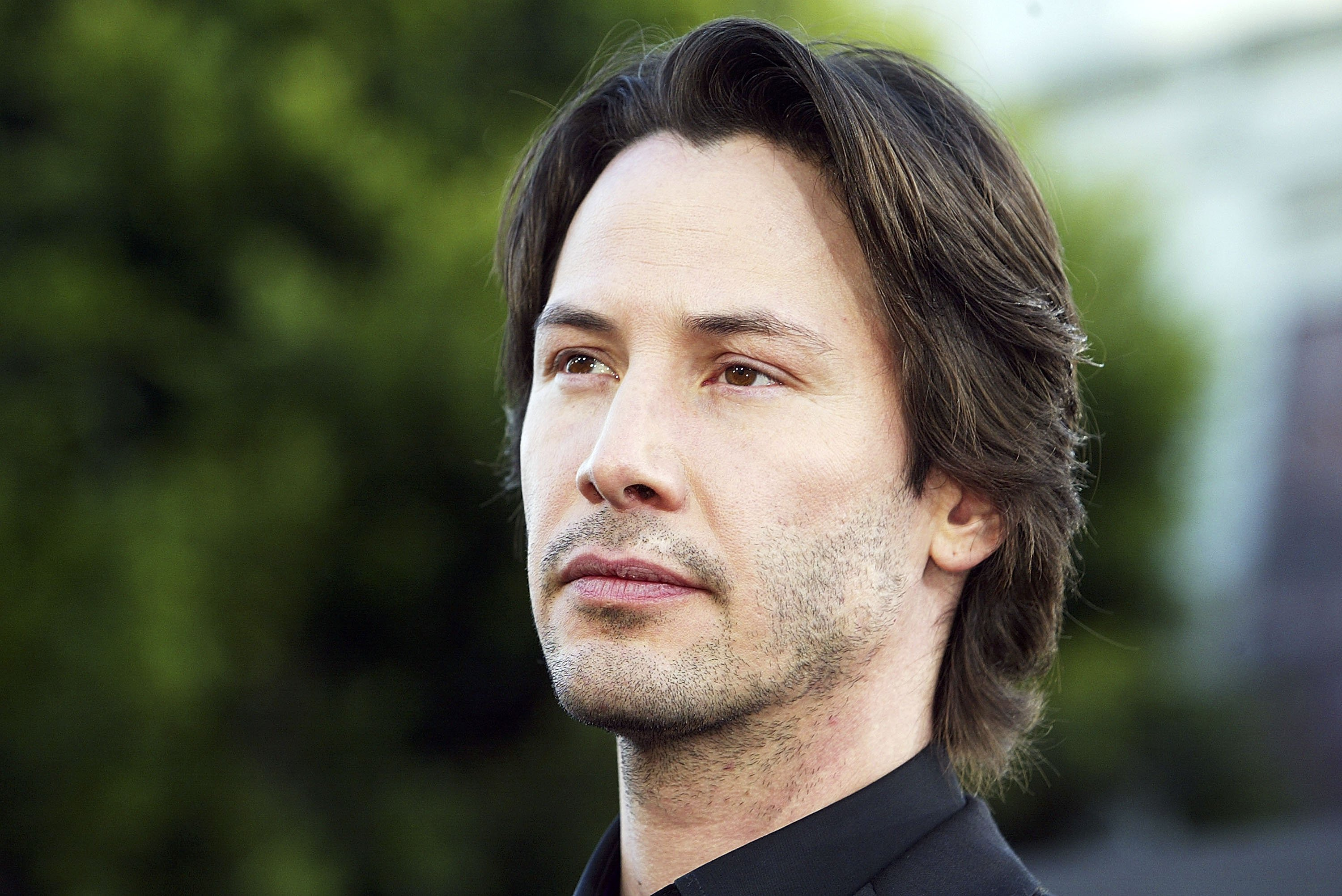 """Keanu Reeves attends """"The Matrix Reloaded"""" premiere at the Village Theater on May 7, 2003, in Los Angeles, California. 