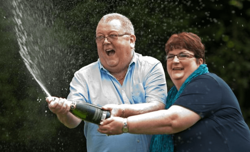 Colin and Christine Weir celebrate their over $220 million Euromillions lottery winnings in 2011 | Photo: Twitter/@DailyMirror