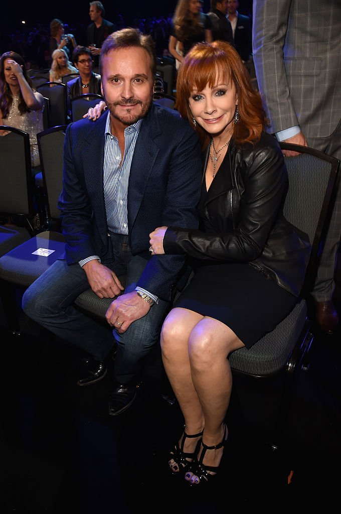 Narvel Blackstock and recording artist Reba McEntire attend the 2014 American Country Countdown Awards. | Source: Getty Images
