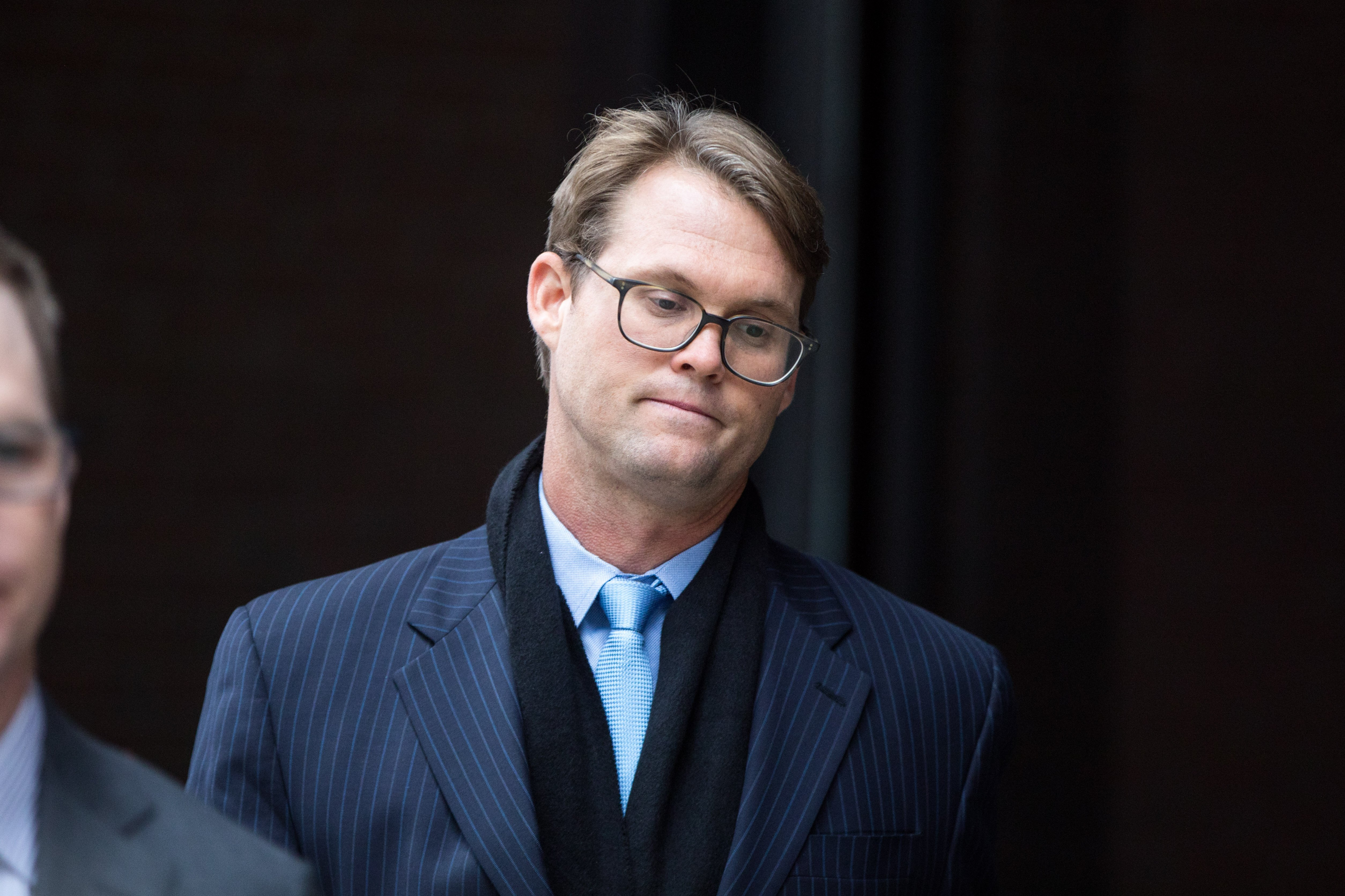 Mark Riddell looking broken after pleading guilty at Boston Federal Court | Photo: Getty Images