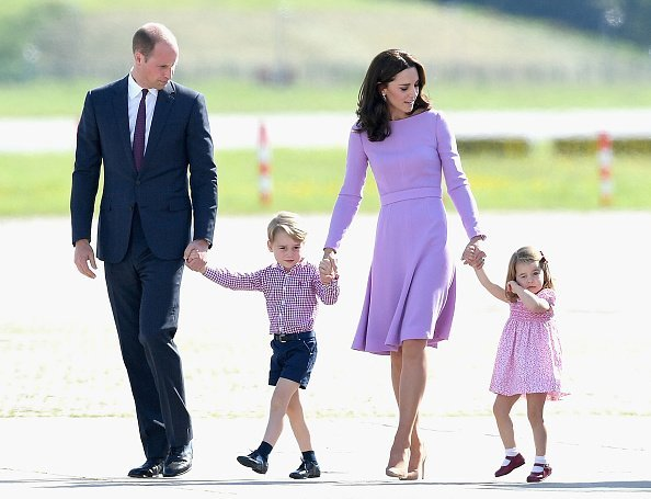 Prince William, Duke of Cambridge, Catherine, Duchess of Cambridge, Prince George of Cambridge and Princess Charlotte of Cambridge view helicopter models H145 and H135 before departing from Hamburg airport on the last day of their official visit to Poland and Germany on July 21, 2017 in Hamburg, Germany | Photo: Getty Images